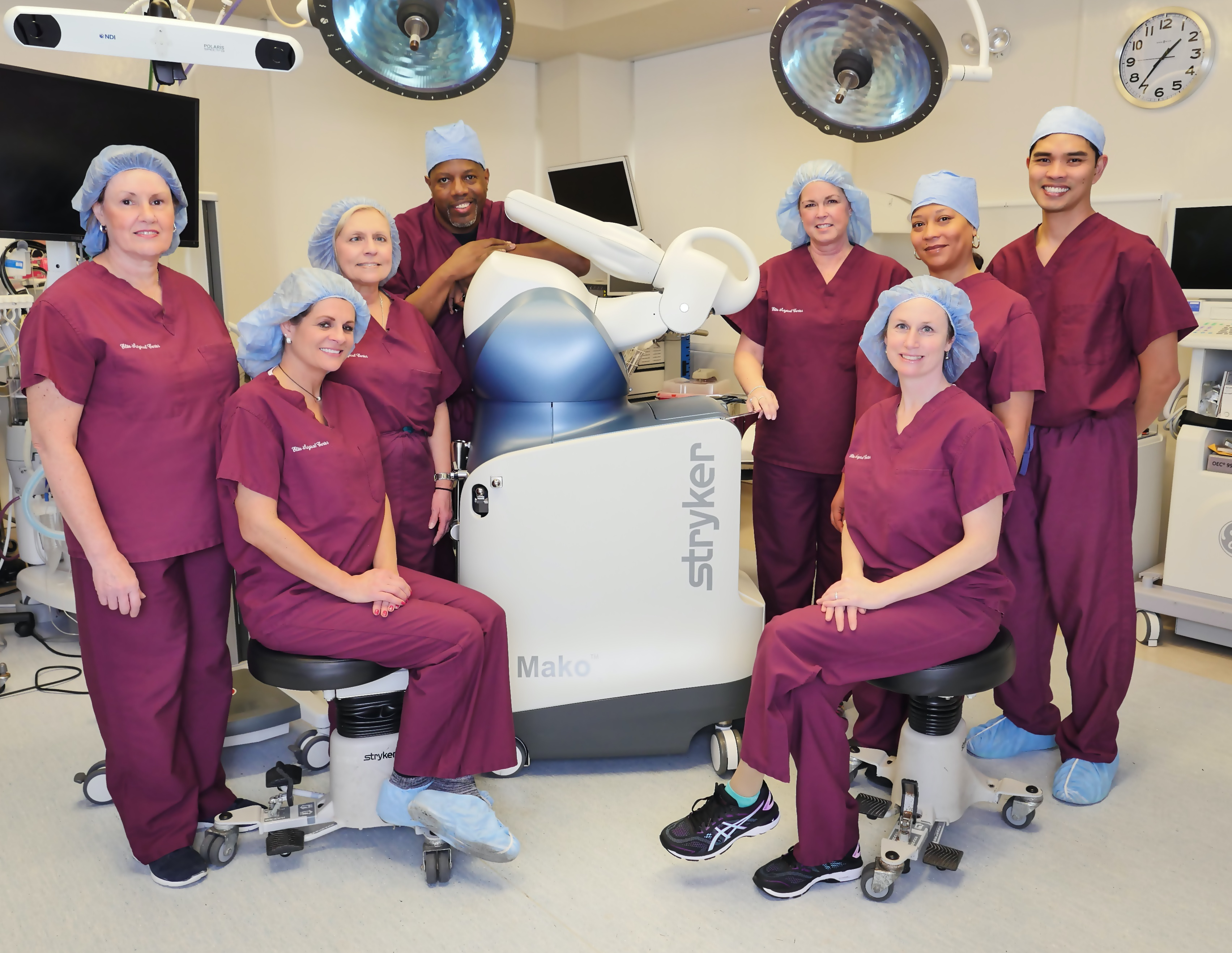 Staff at Elite Surgical Center pose with the Robot Arm