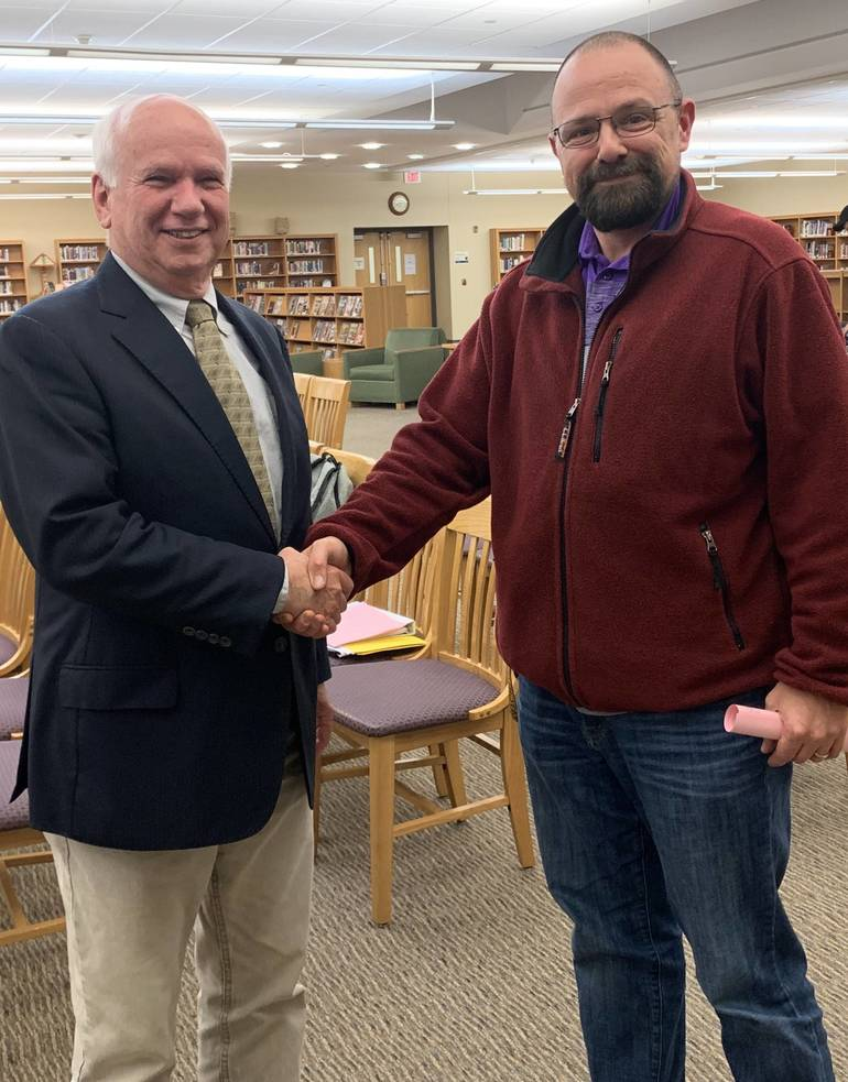 WHRHS teacher Michael Gangluff and Board President Peter Fallon shook hands after the meeting. 0C95DBF5-2F91-439A-AB03-3A4C0AFD922A.jpeg