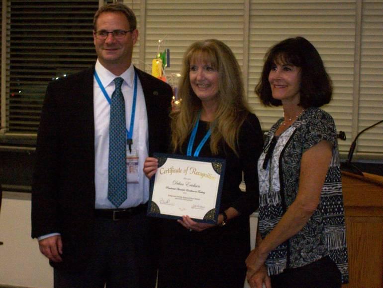 Debra Ericksen (center) with Russell Lazovick and Jill Gladstone