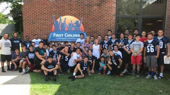 ALJ Crusader Football Team Visits First Children's School