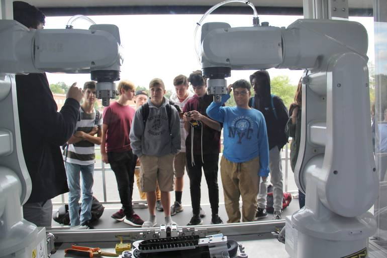 Newton High School Students Meet a Keen Robot Named Oscar