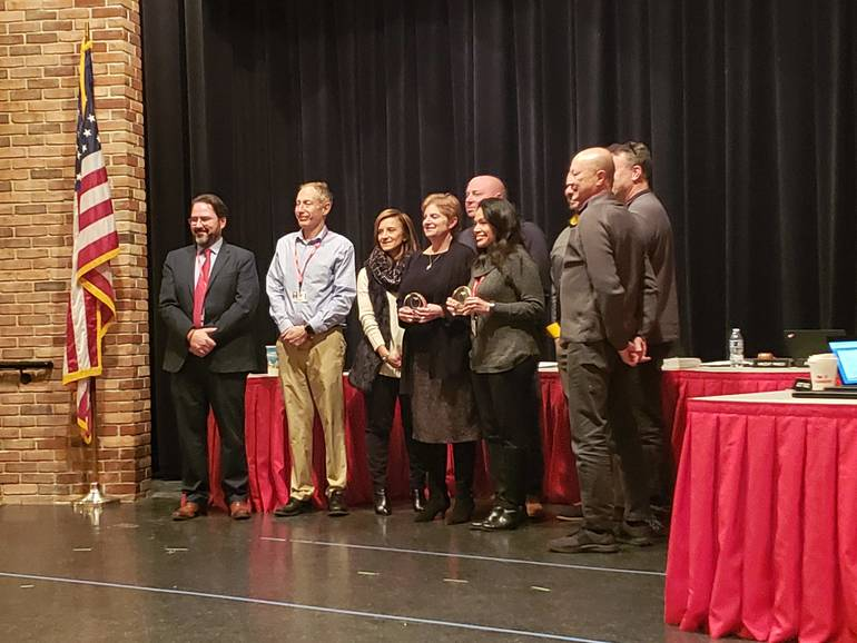 Staff members honored by the board of education
