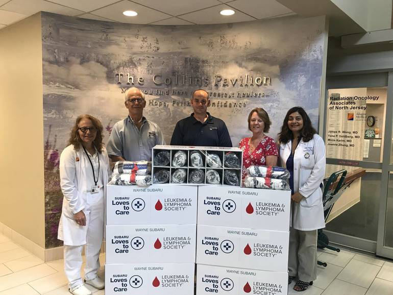 Pictured from left - Sandy Leo, Manager, Infusion Center, Chilton Medical Center; Charles Moltane and Robert Lesko of Wayne Subaru; Mary Fassnacht, MSW and Dr. Mona Karim, Radiation Oncologist of the Cancer Center at Chilton Medical Center