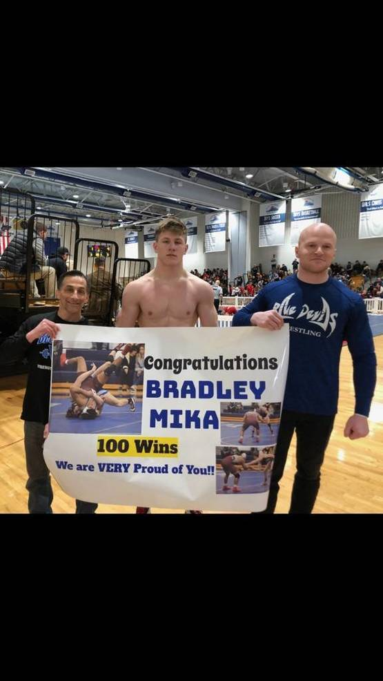 2020 WRHS Bradley Mika 100th pin with coaches.jpg