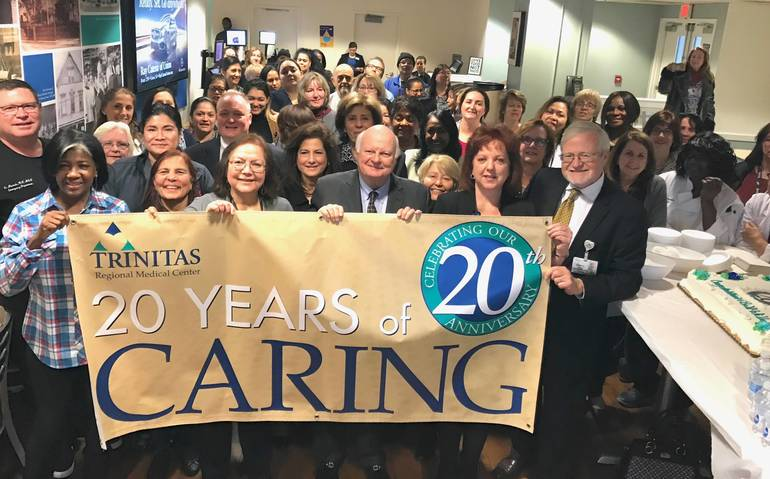 20th Anniversary Banner group shot.jpg
