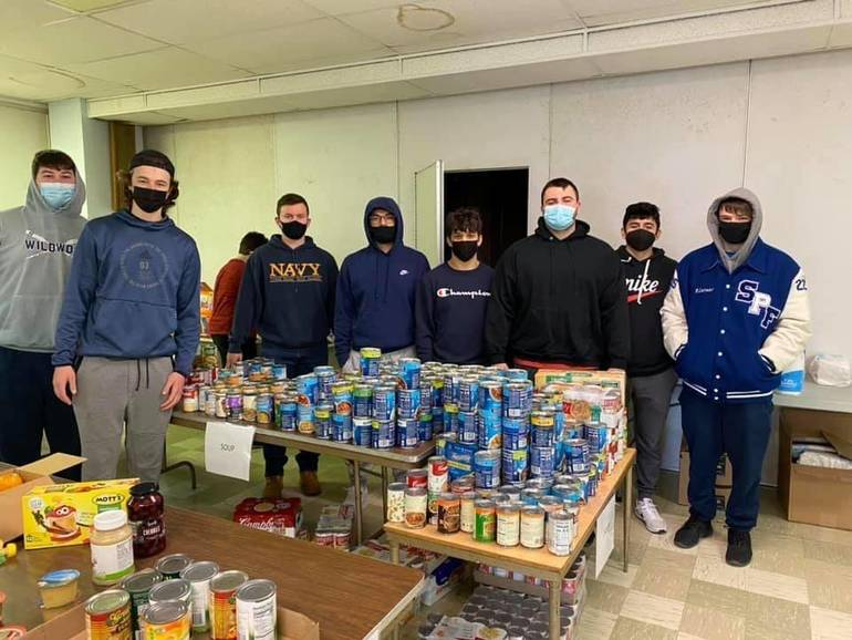 Thomas Ricci, Zack Harmer, Jack Manville, Benjamin Root, Mike Banic, Omar Casimaro, and Robert Lerner volunteer at the IHM food pantry in Scotch Plains.