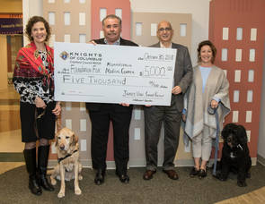 Carousel image fe885994c5d7c36c64ed 2018 k of c golf outing donation to atantic health soothing paws therapy dogs ii