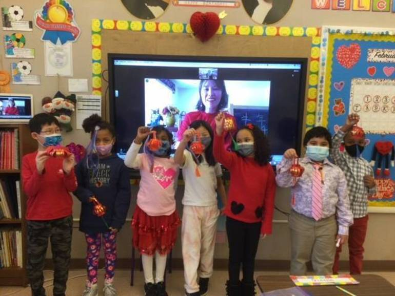 W+H second graders proudly display their Chinese lanterns.