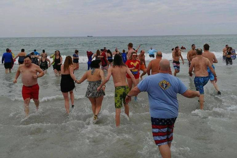 Scotch Plains-Fanwood residents take the Polar Bear Plunge in Seaside to benefit Special Olympics New Jersey.