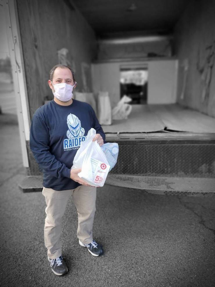 Scotch Plains Deputy Mayor Josh Losardo makes a non-perishable food donation.