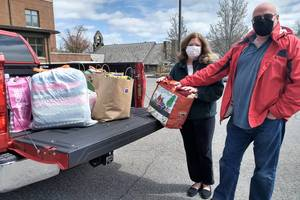 Crafters, Quilters Donate Items to Project Linus
