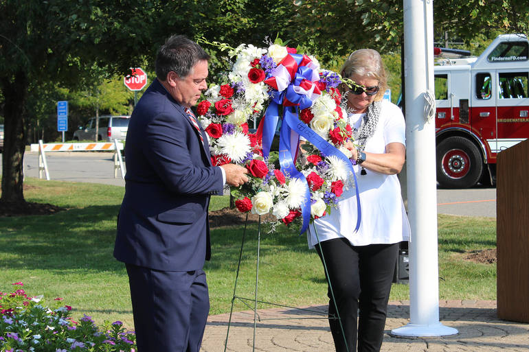 Mayor Dan Hayes and Councilwoman Christine Henderson Rose place the wreath.
