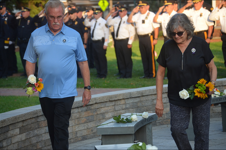 Matthew Horning's parents, Kurt and Diane, lay flowers on the memorial for their son in Scotch Plains.