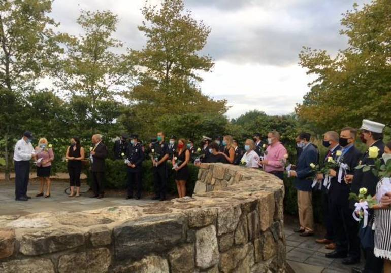 Lining up to lay flowers remembering those lost on 9/11