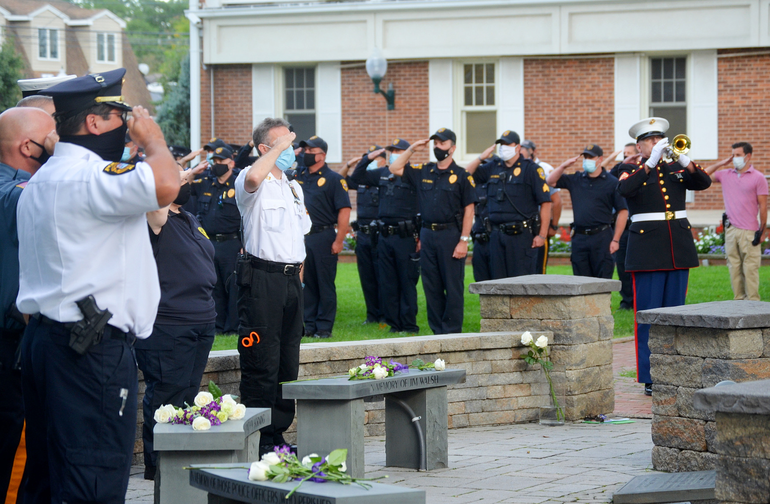 Police, fire and rescue squad leaders salute at the Scotch Plains /11 memorial service on Friday, Sept. 11, 2020.