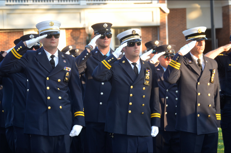 Firefighters from Fanwood and Scotch Plains salute