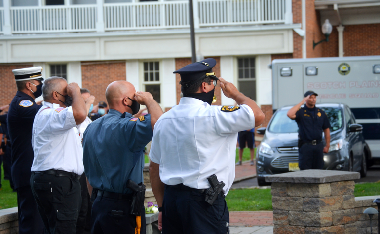 Scotch Plains and Fanwood emergency service workers salute at the Scotch Plains 9/11 memorial service on Friday, Sept. 11, 2020.