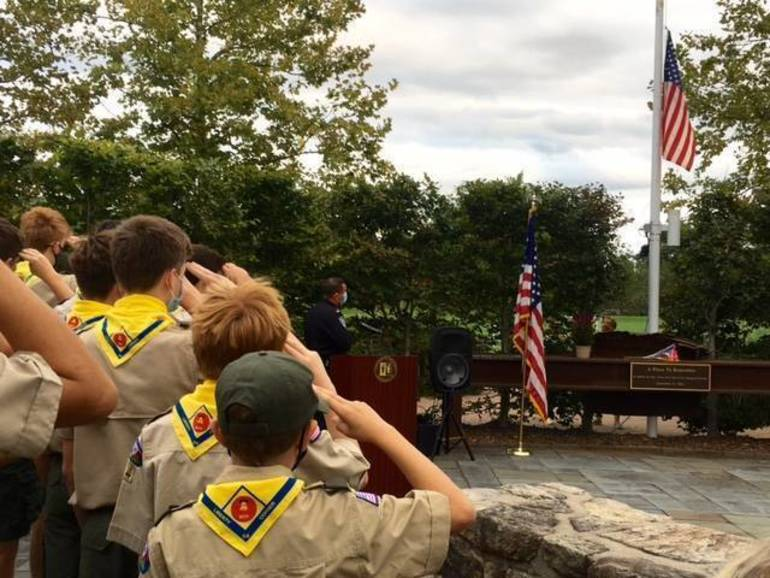 Boy Scout Troop 54 salutes flag