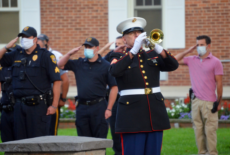 "A bugler plays ""Taps"" at the Scotch Plains 9/11 memorial service on Friday, Sept. 11, 2020."