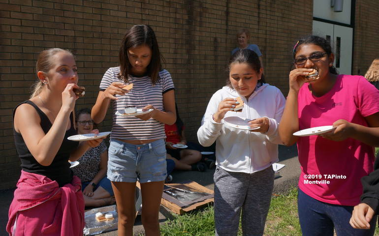 a 7th, 8th and 9th graders munch on s'mores ©2019 TAPinto Montville 1.JPG