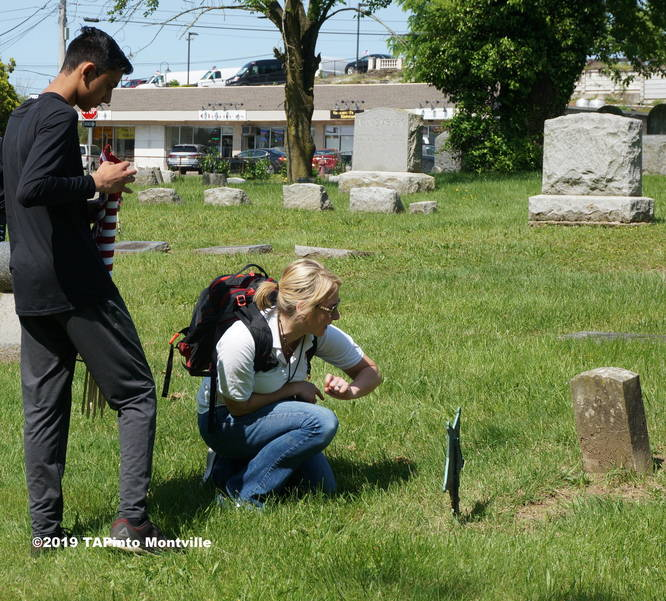 Aadit Nagir and teacher Michelle Trautman check names on a grave ©2019 TAPinto Montville.JPG