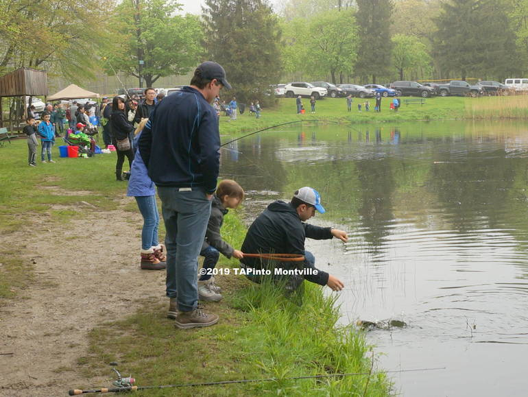 a Arya and Anthony Goglia reel in their fish ©2019 TAPinto Montville.JPG