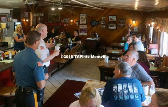 Top story 45c8378c81a68899e816 a acting chief andrew caggiano  left in blue  and morris county sheriff james gannon  in white  address diners at the red barn restaurant regarding coffee with a cop  2018 tapinto montville