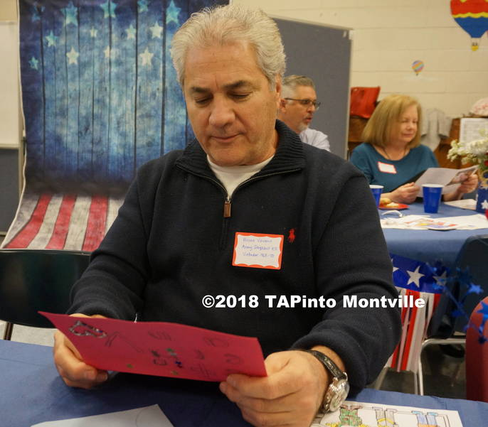 a Bruno Varano reads a card from the students.JPG