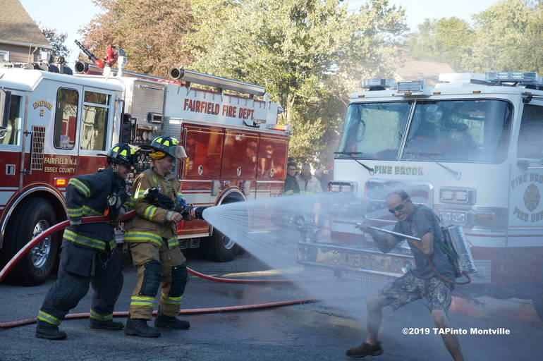 A bystander gets a dousing ©2019 TAPinto Montville.JPG