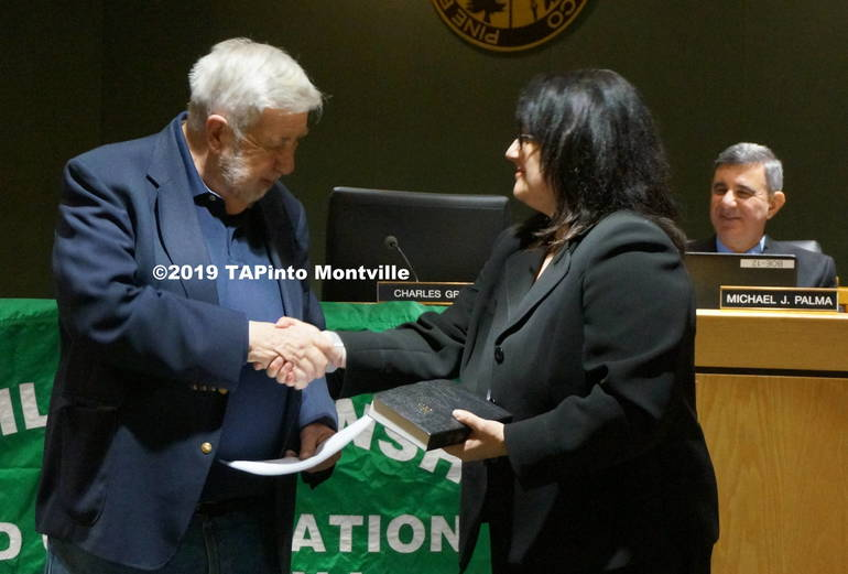 a Charles Grau shakes Katine Slunt's hand after taking the oath of office ©2019 TAPinto Montville.JPG