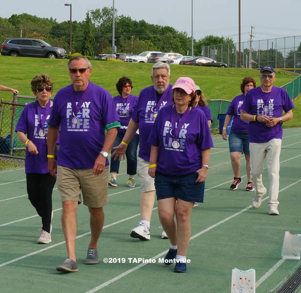 a Charles Grau, center, and other survivors, take a lap ©2019 TAPinto Montville.JPG