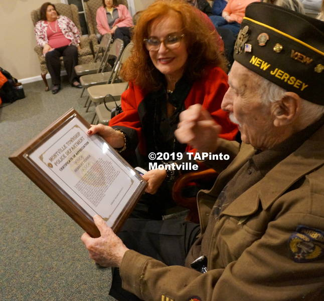 a Carole Krupnick shows her father a plaque from the Montville Twp Police Dept ©2019 TAPinto Montville.JPG
