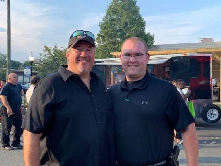 Adminstrator Glenn Cullen with Officer Bori.jpg