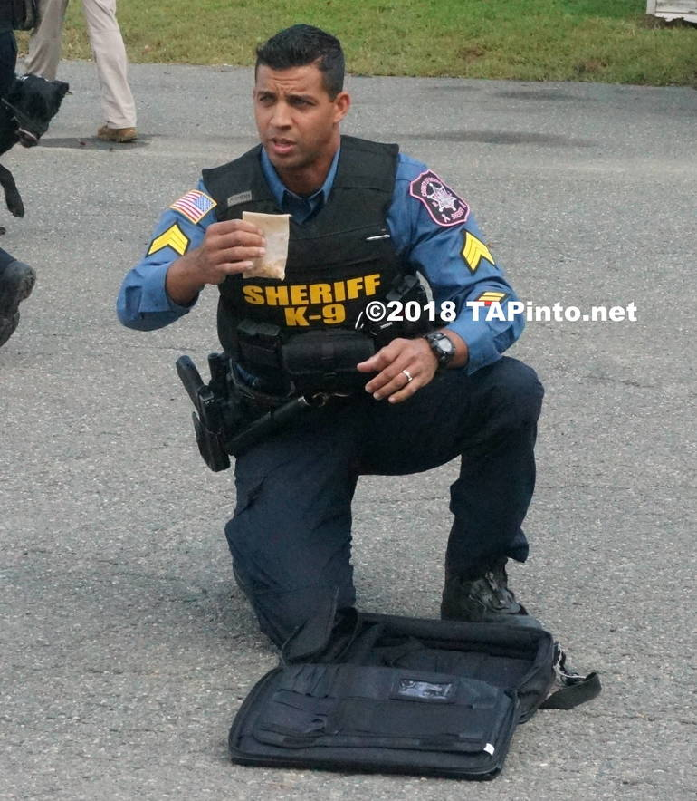 a Det. Sgt.  Aaron Tomasini shows the HMX that Boomer was able to detect in a piece of luggage ©2018 TAPinto Montville.JPG