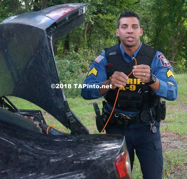 a Det. Sgt. Aaron Tomasini shows the trip wire that Boomer was able to detect in a car ©2018 TAPinto Montville.JPG