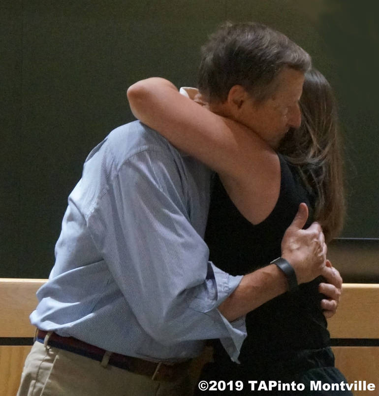 a Father and daughter exchange a hug ©2019 TAPinto Montville.JPG
