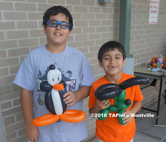 a Hossain, 11, and Ali, 7, enjoy their balloon sculptures at the library's summer reading program finale ©2018 TAPinto Montville.JPG