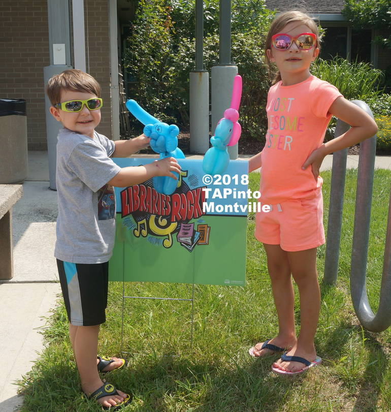 a Kyle and Rebecca Spear show off their balloon animals at the library's summer reading program finale ©2018 TAPinto Montville   2.JPG