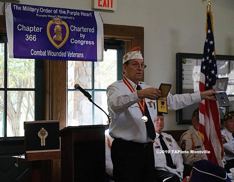 a Ken Hanzl shows Purple Heart awards ©2019 TAPinto Montville.jpg