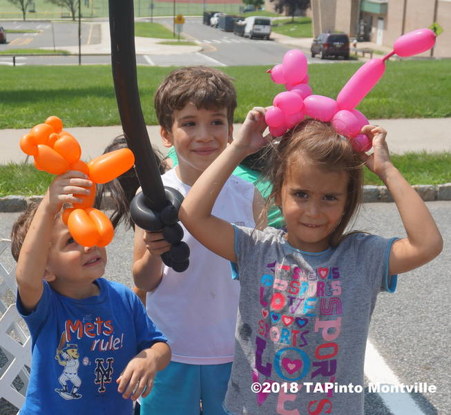 a Levi, Jacob, and Lilliana Rosario enjoy their balloon sculptures after petting some animals at the library's summer reading program finale @2018 TAPinto Montville.JPG