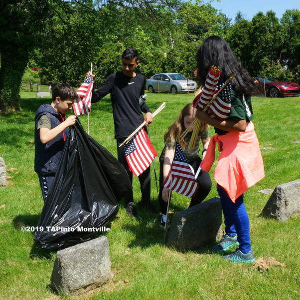 a Lazar students place flags at veterans' graves ©2019 TAPinto Montville.JPG