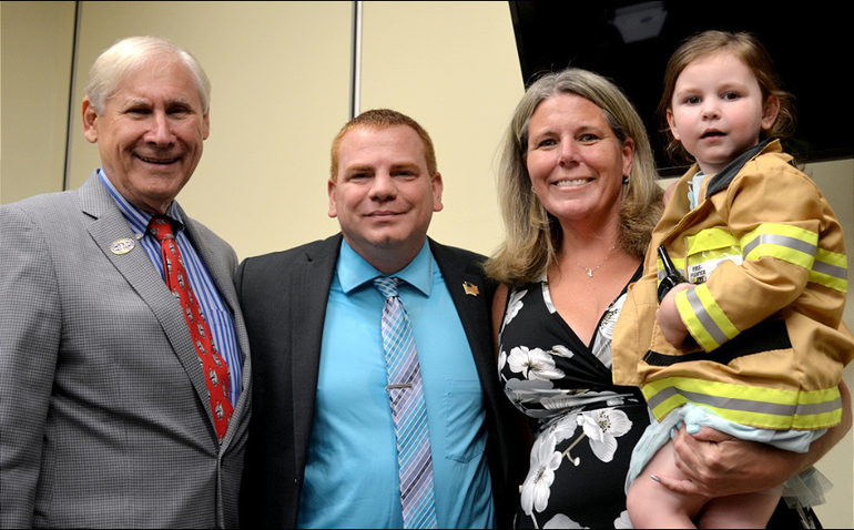 Scotch Plains Mayor Al Smith and new firefighter Ryan Edwish and his family.