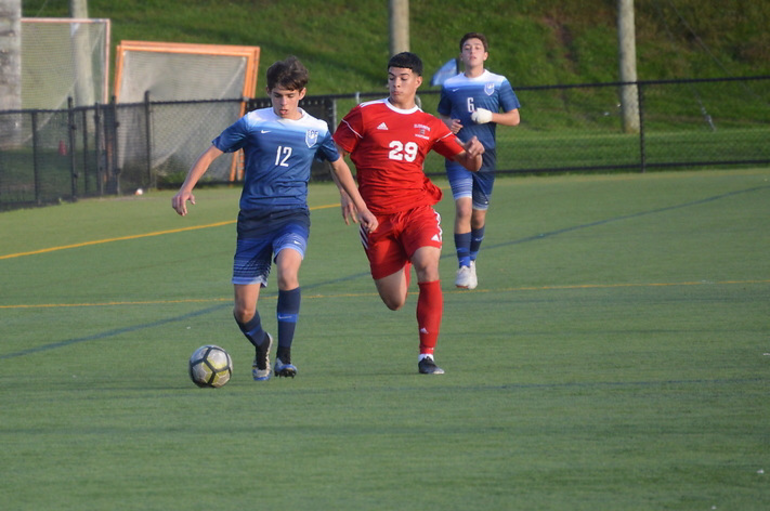Alvaro Furfaro (12) battles for the ball.png