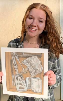 Carousel image 65bfcd4e83f06844aa5b alexa hernandez with a piece of her artwork