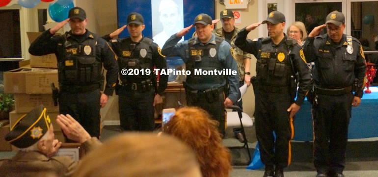 a Montville Twp Police salute Herbert Turner, who returns the salute ©2019 TAPinto Montville.JPG