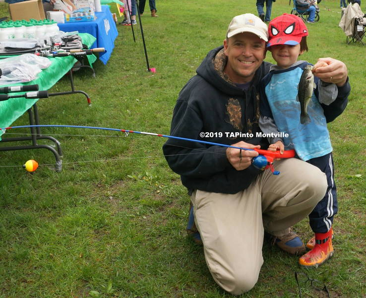 a Maxwell DaCosta with dad and fish ©2019 TAPinto Montville.JPG