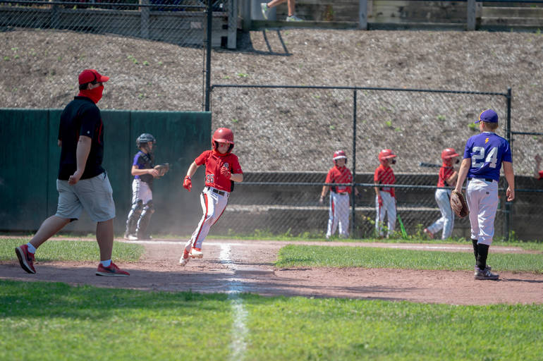 Andrew Cafaldo rounds into first base.JPG