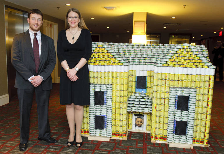 Andrew W. Lewis in 2013 with NK Architect colleague Marlene Borruso and the CANstruction replica of one HSI's affordable housing projects..jpg