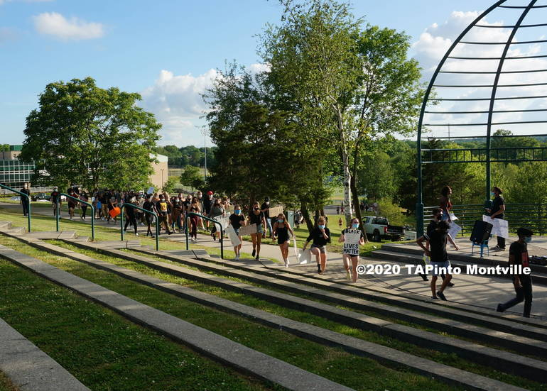 a People file into the amphitheater area ©2020 TAPinto Montville.JPG