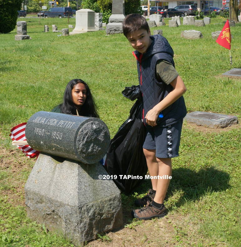 Aparna Narisetti and Jake Martinez replace flags ©2019 TAPinto Montville.JPG